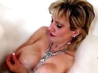 Unfaithful Brit Cougar Gill Ellis Flashes Her Monster Ballo